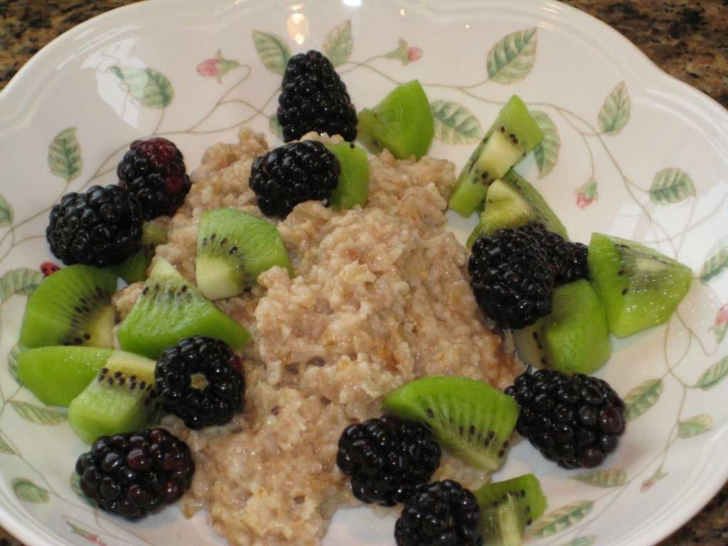 Winter kiwi and blackberries brighten hot cereal.