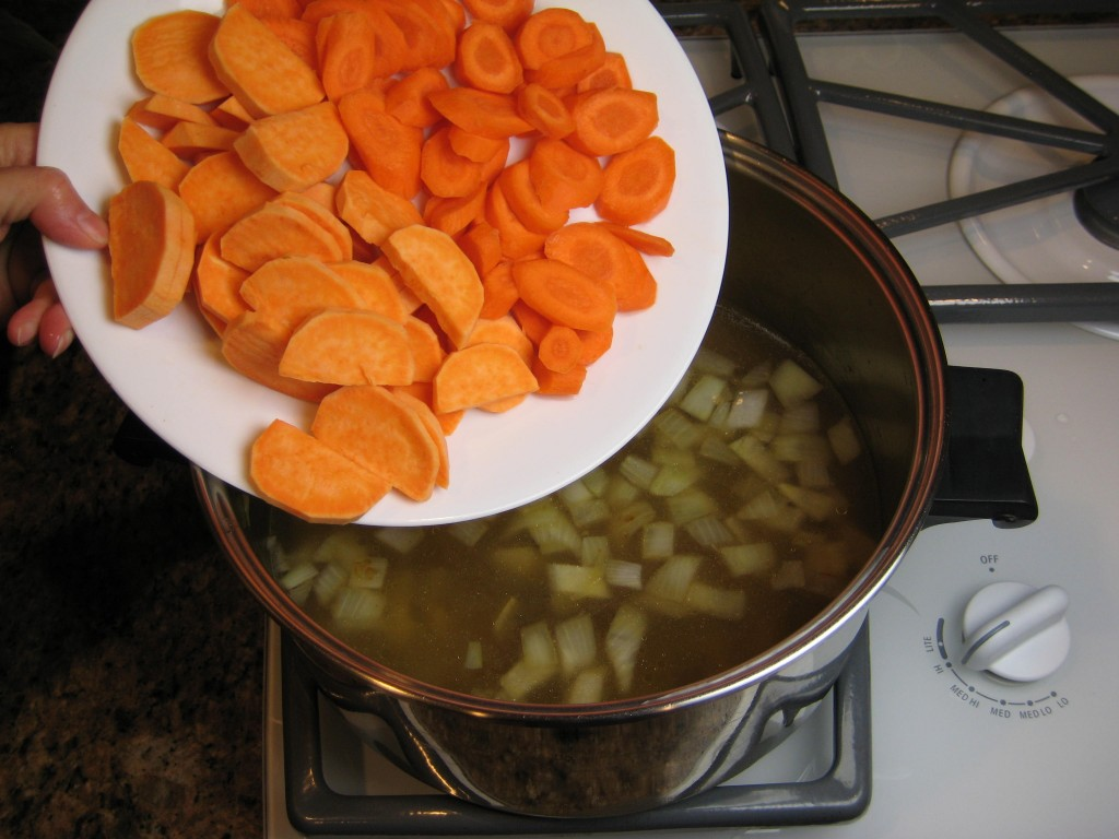 Yams and carrots ready to take the dive.