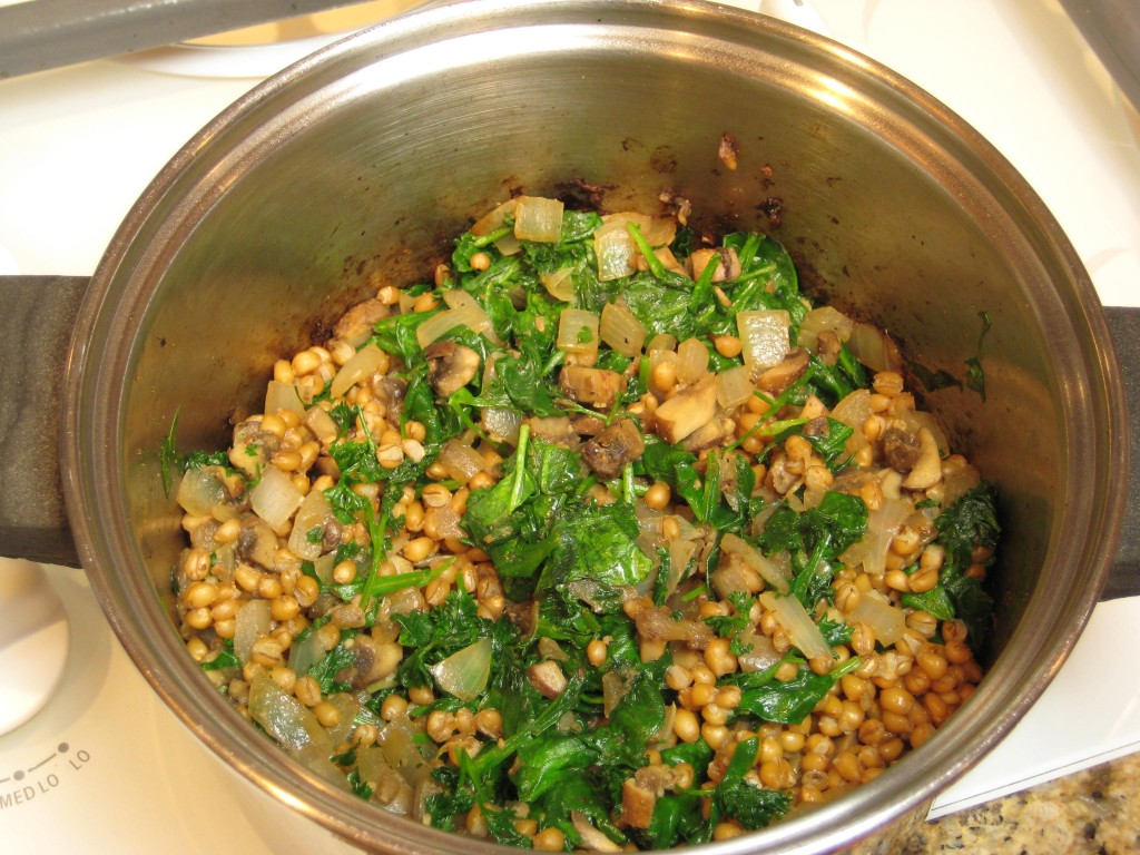 Add greens to wheat berries.