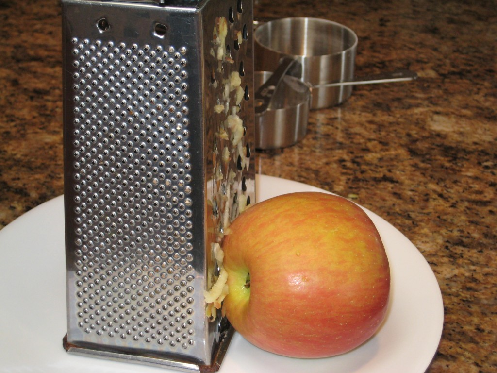 Grate the unpeeled apples.