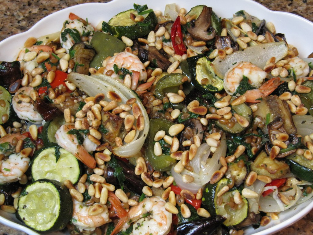 Serve the roasted vegetables folded into the shrimp mixture; and sprinkle with pine nuts.