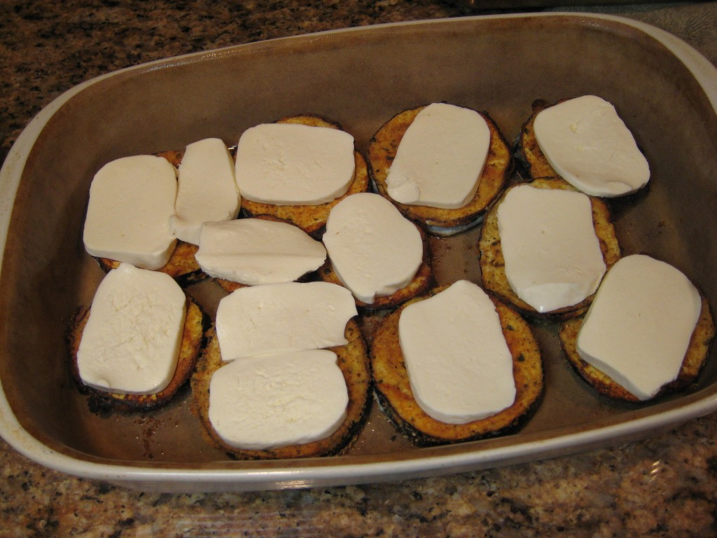 Put mozzarella cheese slices on top of eggplant circles.