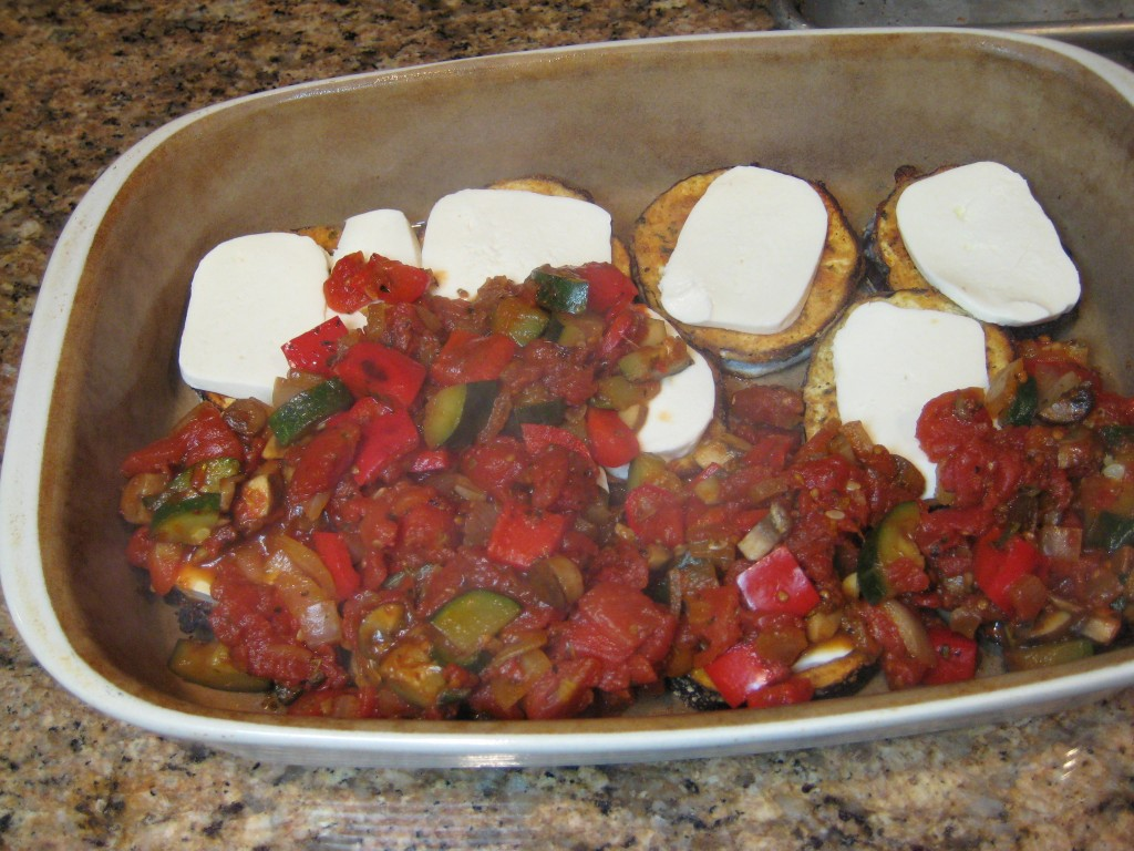 Cover eggplant and mozzarella with tomato/vegetable sauce.