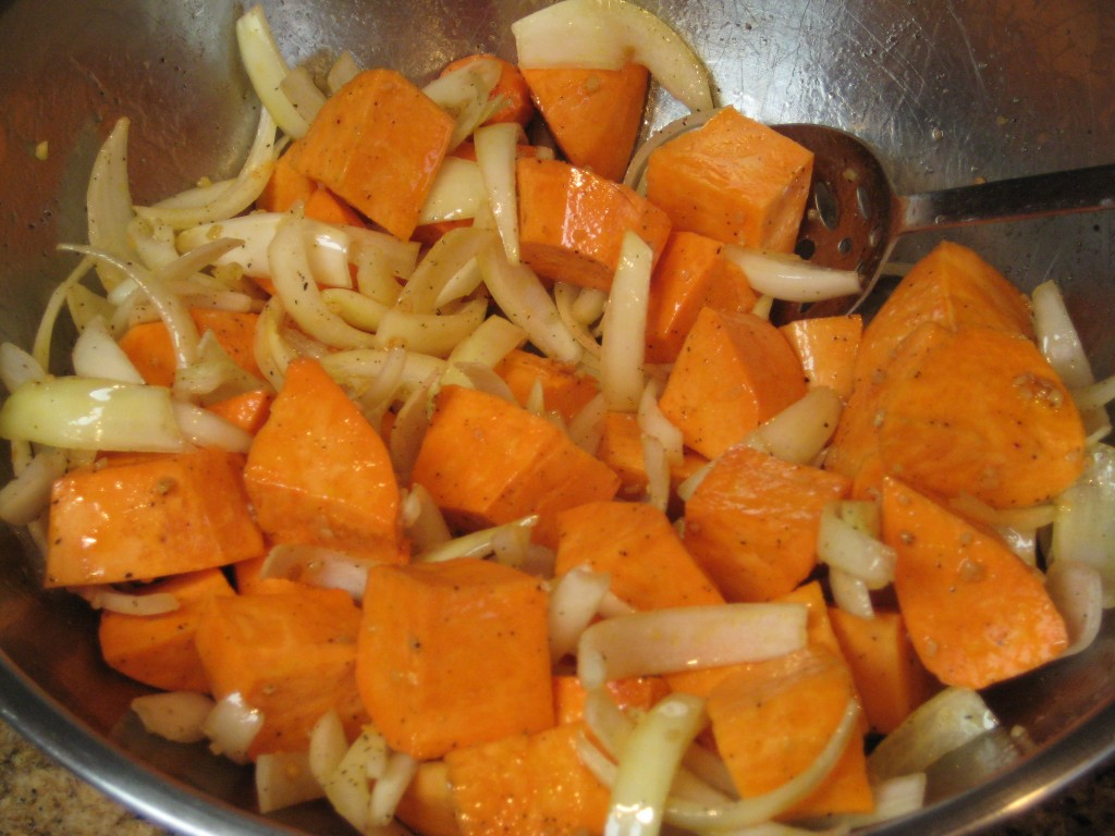 Toss the yams, onions and seasonings with oil to coat.