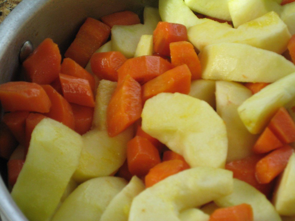 Add the apples to the carrots.