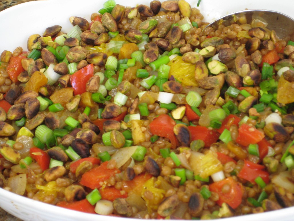 Put into serving dish, sprinkle with green onions and pistachios.