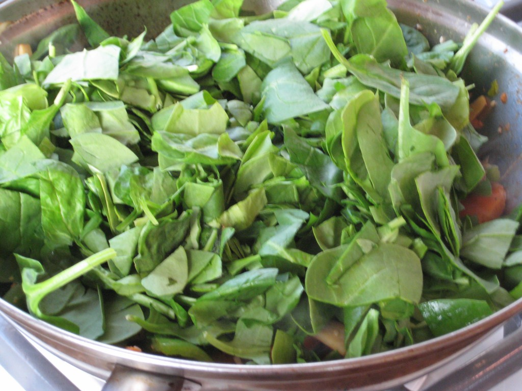 Add the coarsly chopped spinach, it will wilt just stirring it into the hot wok.
