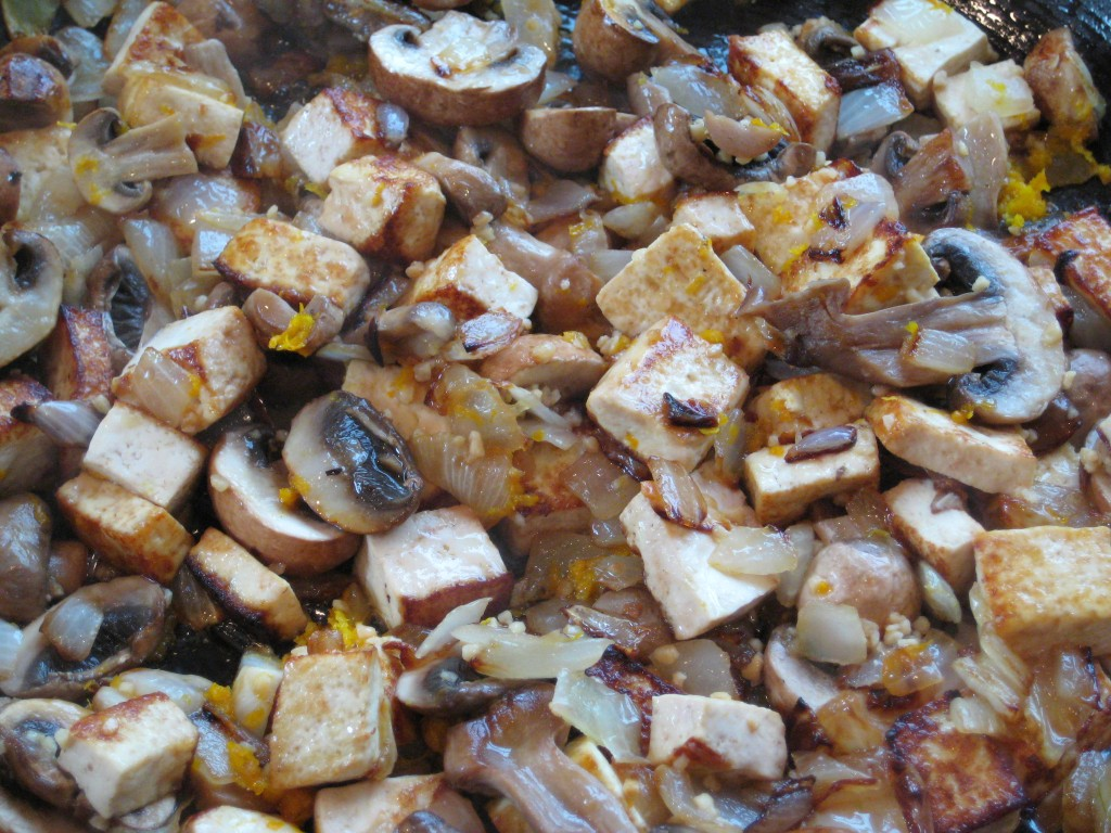 Beginning to add the second group of ingredients to the browned tofu, onions and mushrooms.