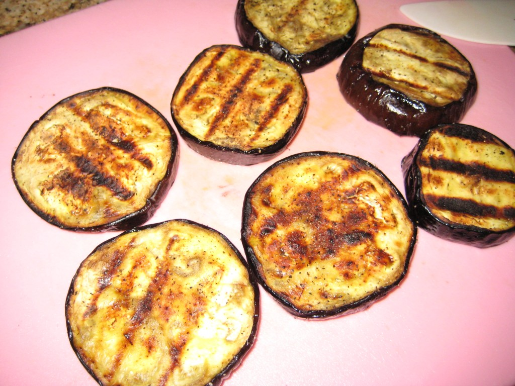 Cut the grilled eggplant slices into bite-sized pieces.