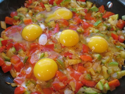Add eggs right to the top of the tender veggies.