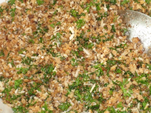 Fresh toasted-bread topping ingredients mixed with the oil.